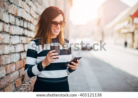 Pretty girl stand on the street with cup of coffee by the cafe w Stock photo © dashapetrenko