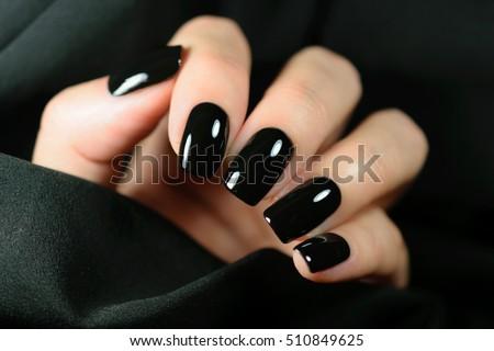 Manicure. Black matte nail polish. Manicured nail with black mat Stock photo © serdechny