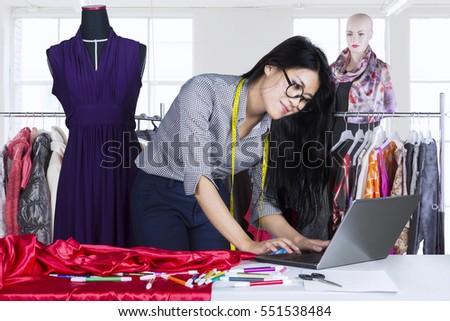 stylish fashion designer working with measure red dummy as sketc stock photo © freedomz
