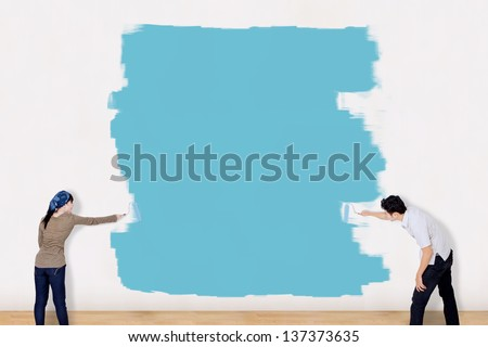 Interior working, Two painter painting the wall with paint rolle Stock photo © Freedomz