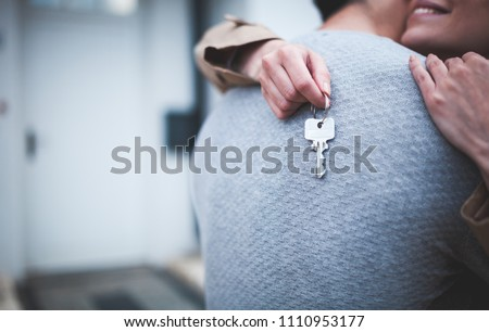 happy young woman holds the key to the apartment or house. The lucky winner. Owning real estate conc Stock photo © galitskaya