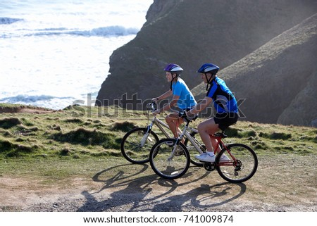 Side view of happy senior man rides a bicycle with senior woman sitting on handlebar at beach in the Stock photo © wavebreak_media