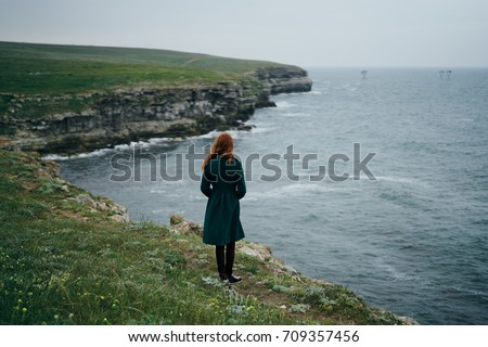 Side view of a beautiful woman standing on the rock and revitalizing at beach on a sunny day Stock photo © wavebreak_media