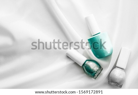 nail polish bottles on silk background french manicure products stock photo © anneleven