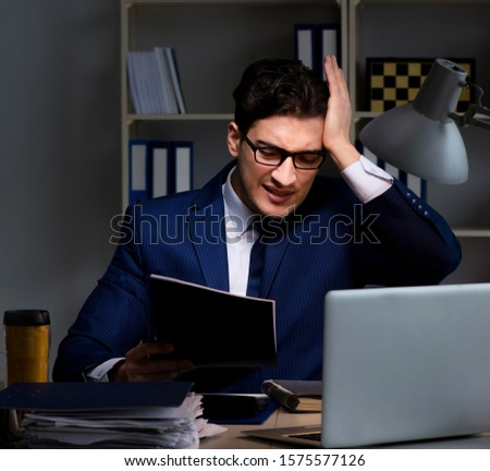 The employee working late to finish important deliverable task Stock photo © Elnur
