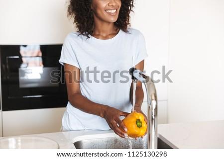 Kép boldog fiatal afroamerikai nő telefonbeszélgetés Stock fotó © vkstudio