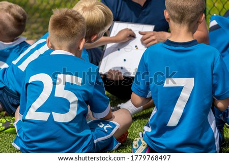 Group of Young Boys Sitting on Sports Grass Field witch School Coach. Kids Listening Coach's Tactic  Stock photo © matimix