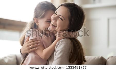 A family of two people mother and baby girl hug and enjoy life Stock photo © ElenaBatkova