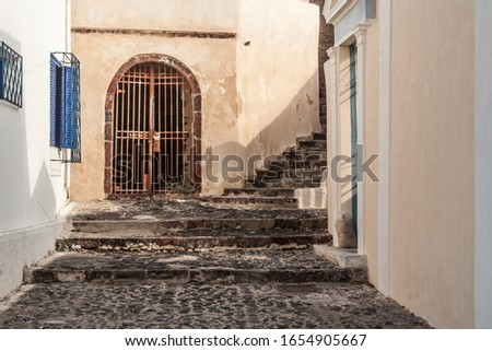 Ancient Cobblestone Walkway and Steps Among Building in Santorin Stock photo © feverpitch