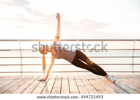 Abs workout - fitness woman working out on beach doing russian twists abs exercises with raised legs Stock photo © Maridav