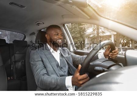 Positief geslaagd mannelijke ondernemer luxe zwart pak Stockfoto © vkstudio