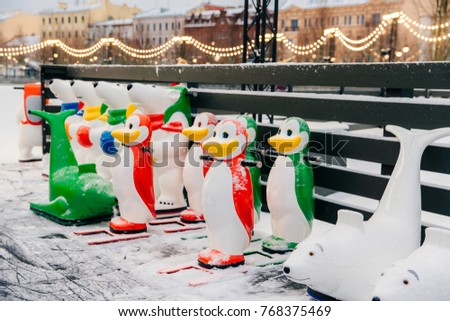Special figures made in shape of animals stand on ice rink, used by beginners who learn ice skating. Stock photo © vkstudio