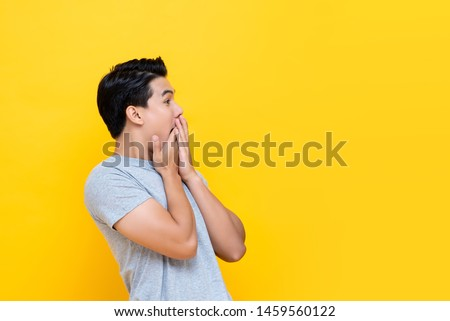 Surprised and speechless young shocked handsome man in t-shirt, gasping amazed, drop jaw and stare c Stock photo © benzoix