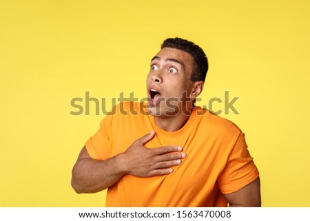 Shocked young man scared death or heart attack, touching heart gasping speechless and terrified, sta Stock photo © benzoix