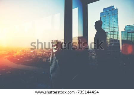 People and career concept. Young entrepreneur in rich suit, thinks about future of his company, stan Stock photo © vkstudio