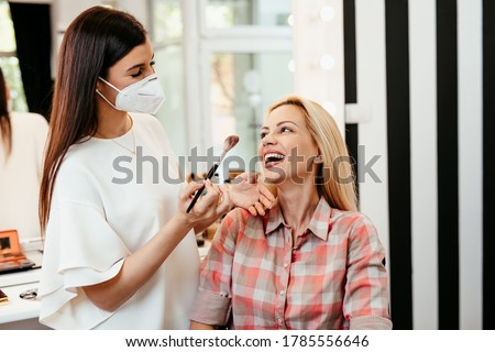 Middle aged pretty woman with protective mask working at home du Stock photo © digoarpi