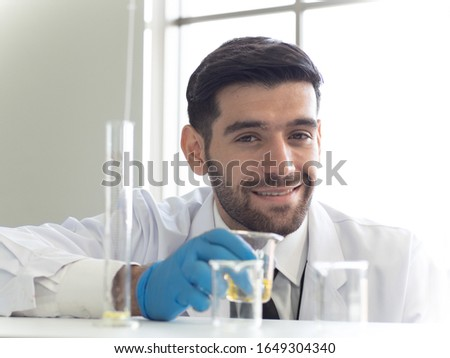Portrait of caucasian male chemist scientific researcher using microscope in the laboratory interior Stock photo © galitskaya