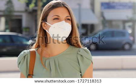 COVID-19 girl walking in city street wearing face mask. Mandatory wear Asian woman commuting using m Stock photo © Maridav
