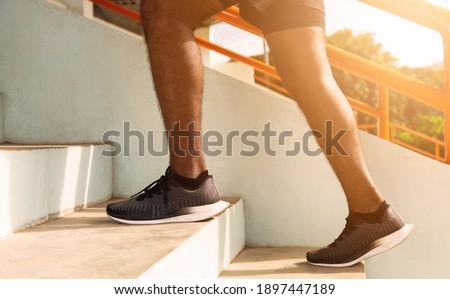 Runner человека спортсмена работает вверх лестницы Сток-фото © Maridav