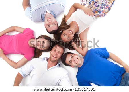 Portrait of fresh and beautiful man and woman lying around flowers and taking spa treatment Stock photo © get4net