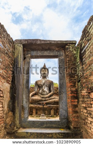 reclining buddha view through a window with a wooden frame onto stock photo © 3523studio