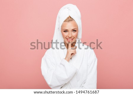 happy young woman holds finger on her lips, silent please, studi Stock photo © pedromonteiro