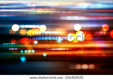 blurred defocused lights of heavy traffic on a wet rainy city road at night stock photo © ikopylov