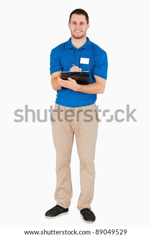 Smiling young salesman making a survey against a white background Stock photo © wavebreak_media