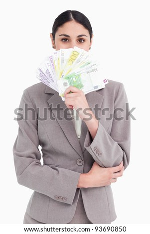 Businesswoman hiding with bank notes in her hand against white background Stock photo © wavebreak_media