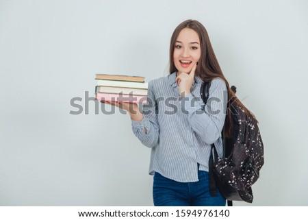 Sonriendo adolescente pie dedo mejilla los brazos cruzados Foto stock © wavebreak_media