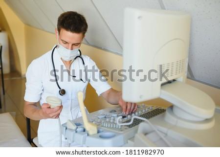 Portrait of young male technician operating ultrasound machine Stock photo © bartekwardziak