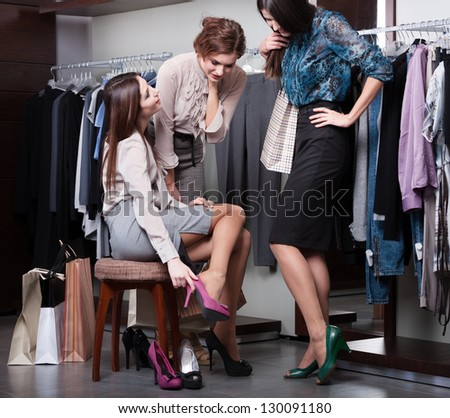 Beautiful woman shopping in clothing store trying on brown hat  Stock photo © HASLOO