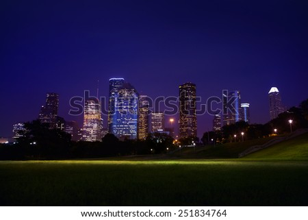 View on downtown Houston by night with bridges in colorful light Stock photo © meinzahn