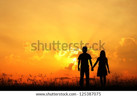 Young Couple Man Woman Engaged Standing Hugging Kissing Embracing Stock photo © cboswell