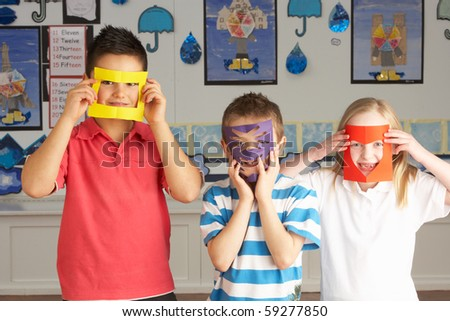 Female Primary School Pupil Cutting Out Paper Shapes In Craft Le Stock photo © monkey_business