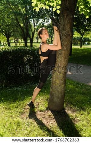 Fiatal lány függőleges pozició zsinór fehér mosoly Stock fotó © vlad_star