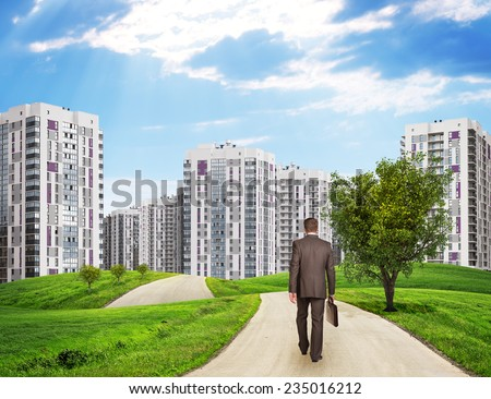 Businessman walks on road. Rear view. Buildings, grass field, wooden signboard and sky with virtual  Stock photo © cherezoff