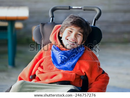 Handsome disabled eight year old biracial boy smiling and relaxi Stock photo © jarenwicklund
