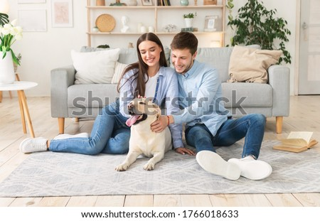 Family sitting on the couch with golden retriever in foreground Stock photo © wavebreak_media
