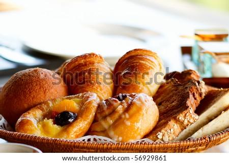 freshly made breads croissant served for breakfast with orange fruit stock photo © flariv
