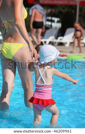 beautiful woman and little girl going on paddling pool in aquapa stock photo © paha_l