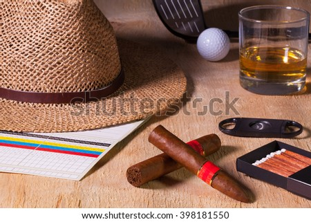 Siesta - cigars, straw hat and Scotch whiskey on a wooden desk Stock photo © CaptureLight