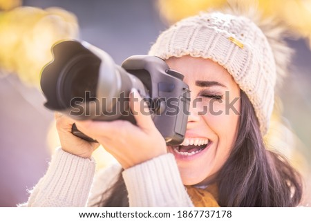 male photographer taking pictures of happy woman in winter forest stock photo © deandrobot