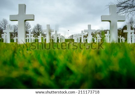 Grave of a fallen soldier. Death of the military. Cross and helm Stock photo © popaukropa