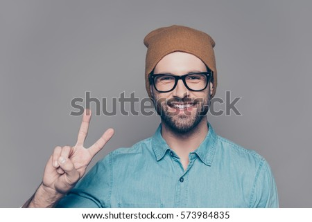 young attractive bearded hipster man gesturing emotional screaming in studio sucsess fashion modern stock photo © iordani