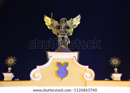 strong knight hand with beautiful sword and shield on the middle stock photo © massonforstock