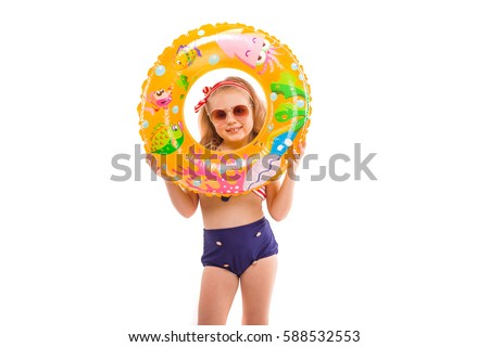 pretty little girl in red striped bikini blue bottoms sunglasses and pink wreath stand stand with stock photo © traimak