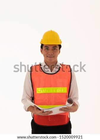 portrait of a smiling young male builder examining paper draft stock photo © deandrobot