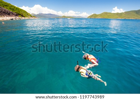 Diving in tropical sea off paradise island. Beach vacation, palm tree, diving mask, oxygen tank, fin Stock photo © orensila