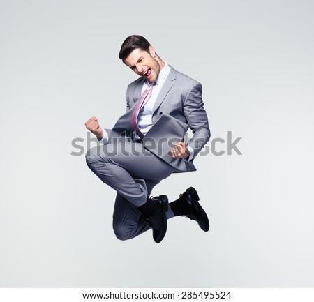 Homme d'affaires gagnant succès excité souriant Homme Photo stock © NikoDzhi